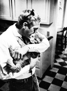 Steve McQueen with his cat, photographed by William Claxton, 1963