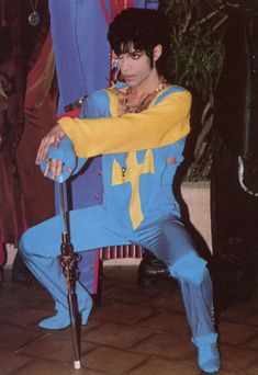 Prince squatting in a jump suit. | 44 Photos That Will Transport You Back To The '90s