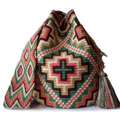 This beautiful, one-of-a-kind #wayuubag was carefully made using a double thread technique for the body. It has a traditional double thread strap and drawstring. The colors and patterns of this #mochilaWayuu was inspired by the vivid colors and shapes that surround region of La Guajira.The time required to elaborate a double thread Wayuu Mochila varies from 10-15 days. Filet Crochet, Fair Trade, Women Empowerment, Cross Stitch Embroidery, Vivid Colors, Artisan, Tapestry, Poufs, Shapes