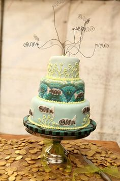 Fish-themed wedding cake (fishing is another love that the bride and groom share).  Cake made by Carrie from Cakes with Feeling, JHB.    Three different flavours:  Double Chocolate Cherry Delight, Vanilla Orange Wish, and Chocolate Peppermint Kiss.  Photo by Dino Codevilla