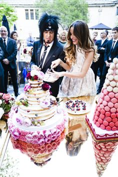 Celebrity Cake Cutting  Photography: Marc Royce Photography Read More: http://www.insideweddings.com/weddings/courtney-bingham-and-nikki-sixx/573/