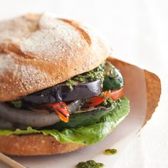 Grilled-Vegetable Sandwich | There's plenty of room for experimentation here. We've used grilled eggplant, zucchini, bell peppers, and onion sandwiched in crusty rolls with a little pesto. Fennel, endive, or mushrooms would make fine vegetable substitutes; sun-dried tomatoes or white-bean puree can replace the pesto; or omit the condiment altogether and top the sandwich with whole fresh basil or mint leaves.