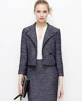 "Addison Jordan Tweed Jacket - Merging sophistication and modern allure, this tweedy style flaunts a finely tuned mix of moto-inspired details. Stand collar with notch closure. Long sleeves with exposed zip cuffs. Asymmetrical double breasted snap closure. Front exposed zip pockets. Lined. 17 1/2"" long."
