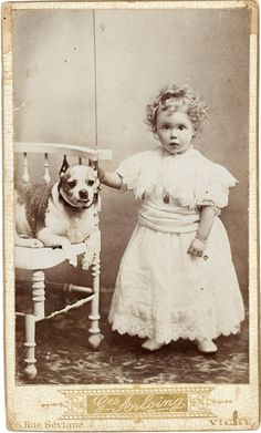 Cute young girl and her somewhat senior dog. From the e-book, Dressing up with Dogs.