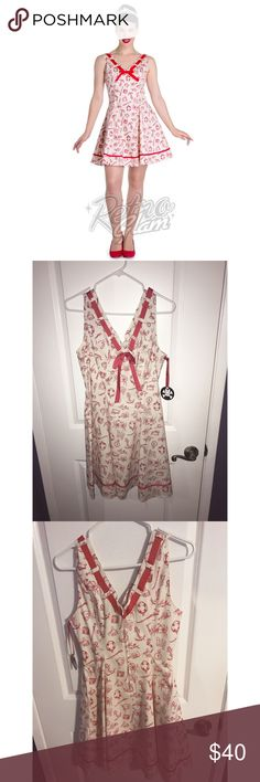 Hellbunny sailor dress ❤️ red and ivory NWT Hell bunny sailor dress.  It has pockets lady's  For reference I'm 28 waist fits great. (Have the navy blue one so don't need another ) and 5 foot 4 and this dress is right above my knees  Dresses