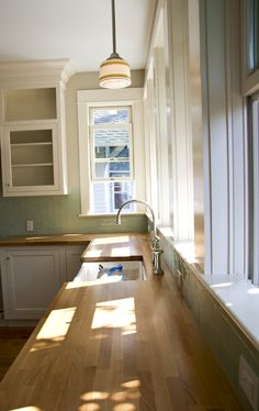 My dream kitchen, pic 3. Butcher block counters, blue-green seaglass-esque color palette, vintage style light fixtures, white cabs.