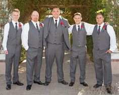 Groom and groomsmen pose in front of the beautiful greenery during a real fall vineyard wedding at Mount Palomar Winery in Temecula, California. #mountpalomarwinery