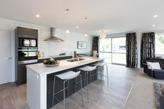 Open plan kitchen and living room for cooking and entertaining. #ClassicBuilders #KitchenDesign