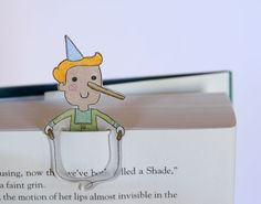 This little guy is a super easy, handy dandy bookmark made with Shrinky Dinks.