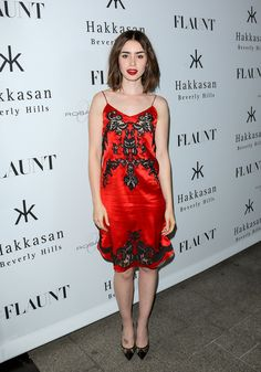 Lily Collins's slinky red dress is perfectly festive.