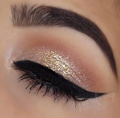 Beautiful winged eyeliner makeup look with nude eyeshadows and glitter