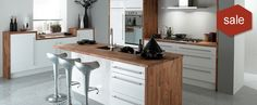 Helsinki - gloss white slab style door. Looks stunning with a walnut worktop and kitchen cabinet.