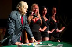 Flanked by women who work at the Maryland Live! Casino, David Cordish with The Cordish Company announces plans for the casino at Arundel Mil...