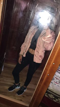 Rose bomber jacket and black nike shoes outfit