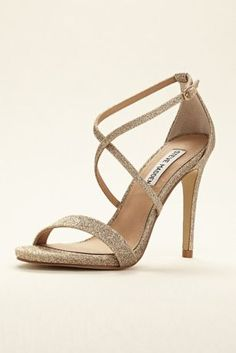 """Versatile and fun! These Steve Madden strappy sandals are the perfect go-to sandal for any event. Sandal features crisscross straps in Glitter Gold and Iridescent Silver. Heel height: 4"""" Fully lined. Buckle closure. Imported"""