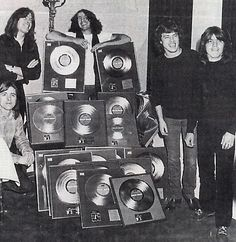 """AC/DC - January 20, 1980 - Cannes, MIDEM (International music event ). In issuing gold records for sales of the albums """"If You Want Blood"""" and """"Highway To Hell"""". Each player received 5 awards!"""