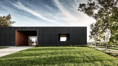 It may look like a high-end contemporary villa, but this rectilinear building is actually a sales office for a dairy farm near Sydney