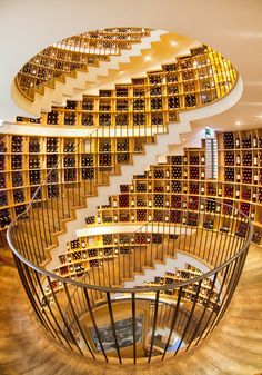 L'Intendant Wine Shop, Bordeaux, renovation by Jean Michel Rousseau, 12-metre high stair encircled by the region's prestigious appellations