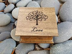 Wooden music box with a tree of life and a Love sign underneath. You can pick your choice of color and song and also add a personalized message to the underside the box
