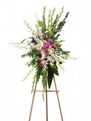 Serenity Spray - Soft a beautiful color tones accent this sympathy arrangement with gladiolas, orchids, and additional flowers shooting out to help frame the design.