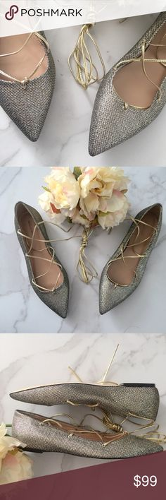 J. Crew glittery lace up flats Such a gorgeous pair of flats! These J. Crew gold glittery lace up flats are brand new and never used! Only flaw is black mark through brand. J. Crew Shoes Flats & Loafers