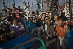 Pakistani children enjoy a ride at a makeshift entertainment park set up in a Christian neighborhood for Christmas holiday, in Islamabad