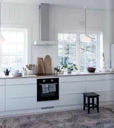 I like the simplicity of it and the white walls and cabinets.  From online magazine BY FRYD 4 via cherry blossom blog.