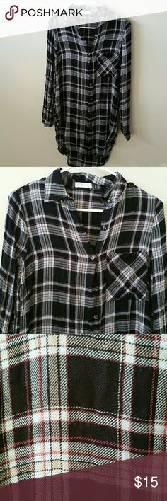 NWOT Plaid Tunic Top Plaid tunic top by Full Tilt. 100% rayon. Comes up high on the sides. New condition. Very slim fit. Full Tilt Tops Tunics