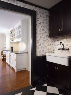 ADORABLE wallpaper and black cabinets