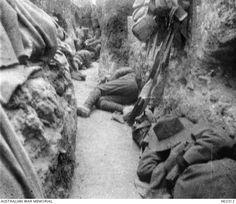 Australian soldiers resting on the floor of a trench, Gallipoli 1915. Australian War Memorial. H02312.