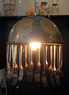 Colander lamp....might also make an interesting wind chime? Maybe with a smaller colander?