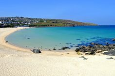 his lookalike starts with the same letters, at least. This is Porthmeor Beach in St Ives, Cornwall. The deep blue water is popular with surfers. Great Places, Places To See, Beautiful Places, Camping Places, Places To Travel, Vacation Places, Vacation Spots, Colorado Springs, Woolacombe Beach