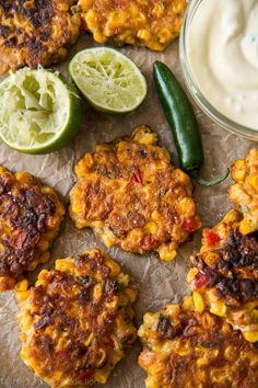 Crispy, savory, and easy corn fritters are all mixed together in 1 bowl. Serve with a cool and creamy honey jalapeño yogurt dip! Recipe on sallysbakingaddic. Spicy Recipes, Appetizer Recipes, Dinner Recipes, Healthy Recipes, Appetizers, Dinner Ideas, Cooking Recipes, Easy Corn Fritters, Biscuits