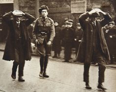 Two Sinn Fein members being arrested by British troops during a raid on the Ministry of Labour offices in Dublin, 1920 Troops, Soldiers, Ireland 1916, Northern Ireland Troubles, Irish Independence, Images Of Ireland, Michael Collins, Irish Roots, Irish Girls