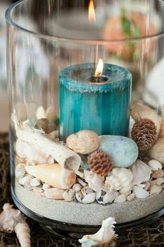 Blue candle shell sand in glass cylinder centerpiece... by victoria