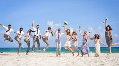 Jump! Fun wedding party portrait idea for beach wedding. Love the long bridesmaid dresses in different shades of grey. | Palace Resorts Weddings ®