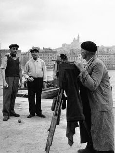 The photographer and bowls players, Marseille, France in 1951 © Robert Doisneau / Rapho