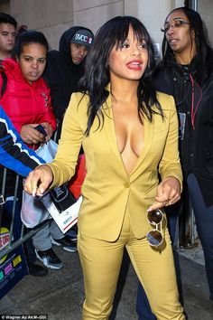 You can't put her in the shade: Christina really cut the mustard in her bold suit and took off her sunglasses to greet fans as she arrived to another interview later in the day