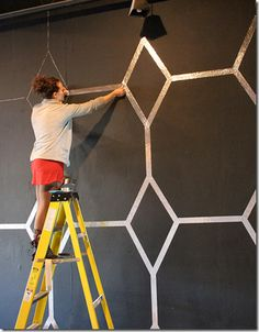 Foil tape on the wall. GENIUS. And really makes a super dark wall a little more livable!