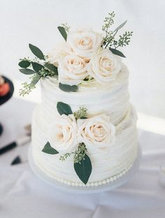 Italian cream wedding cake. Simple, elegant, two-tiered. White roses. (Waldron Photography)
