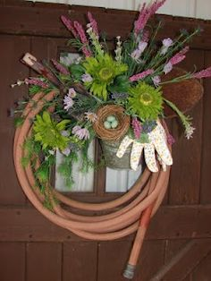 old hose garden wreath - reduce, reuse, recycle