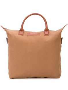 Beige and brown leather and organic cotton O'Hare tote from WANT Les Essentiels featuring top handles, a front logo patch, a top zip fastening and a shoulder strap. Please note this item is unisex and sold in men's sizing. Designer Totes, Shoulder Strap, Shoulder Bags, Hare, Brown Leather, Organic Cotton, Women Wear, Beige, Tote Bag