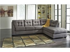 Shop for Signature Design by Ashley LAF Sofa, 4520066, and other Living Room Sectionals at Hi Desert Furniture in Victorville, CA. The comfortable contemporary design of the Maier-Charcoal upholstery collection features plush boxed seating and back cushions giving you the comfort you desire while helping enhance your homes decor with exciting jumbo stitch detailing and tufted accents that embrace the modern style.