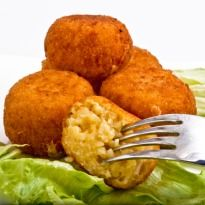 Arancini: Arancini are rice balls wrapped in bread crumbs and baked golden. Arancini is aid to have originated in Sicily, #Italy.