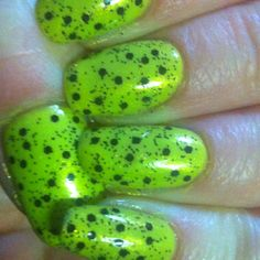 Nubar black polka dot nail polish over revlons zealous. Luvs it