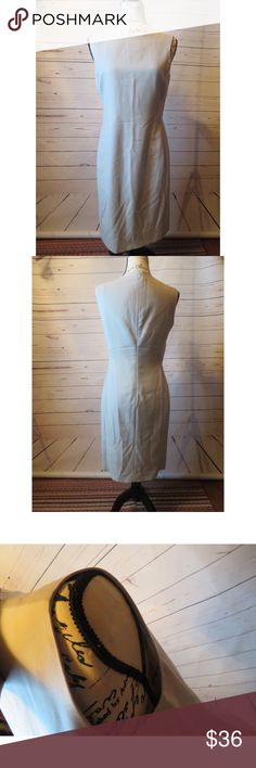 """Calvin Klein Collection Womens 8 Midi Dress Tan Calvin Klein Collection Womens 8 A Line Dress Tan 100% Wool Sleeveless Silk  Gently Used Good Condition  White marks on the front of the dress  Sleeveless Size 8 Made in Italy  Professional Dry Clean Only  Back Zipper   Material: 100% Wool  100% Silk  Measurements  Length: 38"""" Bust: 34"""" Waist: 30"""" Hips: 34"""" Calvin Klein Collection Dresses Midi"""