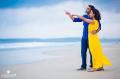 Outdoor pre wedding photo shoot by the beach dressed in smart casual outfits. | weddingz.in | India's Largest Wedding Company | Indian Wedding Photography |