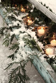 along a path... votive candles and snowy greenery for a festive Christmas welcome