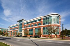 The Maple Lawn Office Building is located in Fulton, MD and features Glen-Gery brick in the color Courtland. Love this unique building and all of the windows! #glengery #redbrick #officebuildings