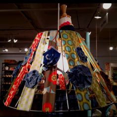 Use an old lamp shade and cover with cloth head bands-makes for a cute and fun way to display new product designs!